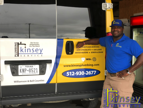 Kinsey Plumbers in front of company turck.