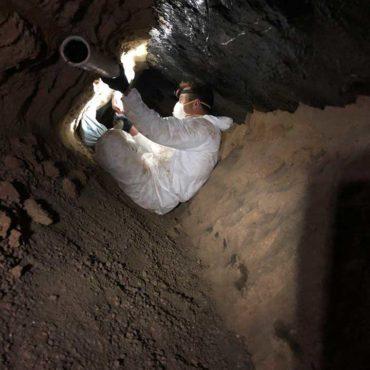 Professional Kinsey plumbers repairing a drain.